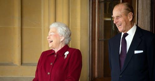 Queen Elizabeth II and Prince Philip share a joke.
