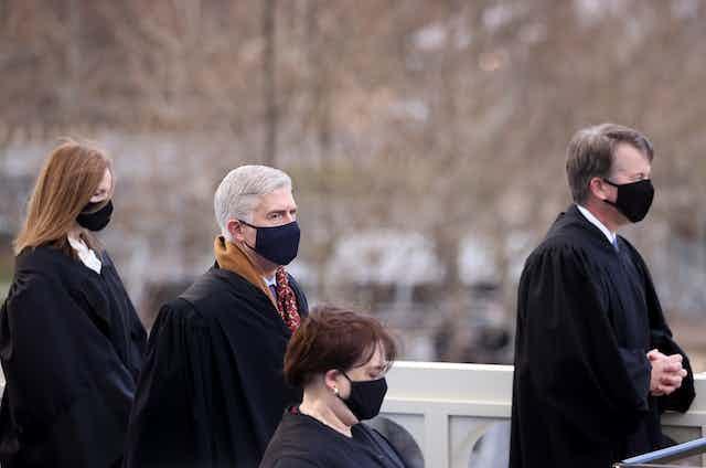 U.S. Supreme Court justices Amy Coney Barrett, Neil Gorsuch, Elena Kagan and Brett Kavanaugh attend President Joe Bidens inauguration.