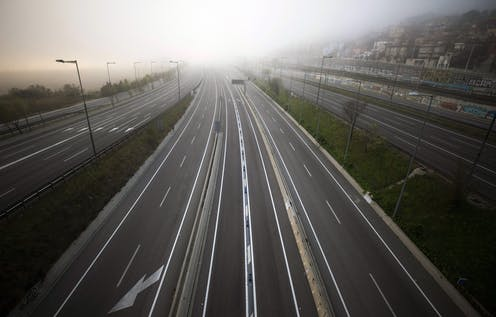 the highway leading to Barcelona is seen empty of cars