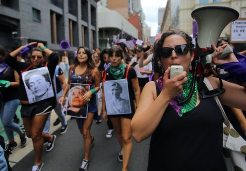 Women marching for gender equality in Sydney.