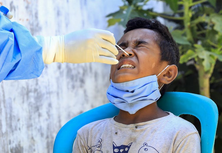 A boy undergoes a COVID test