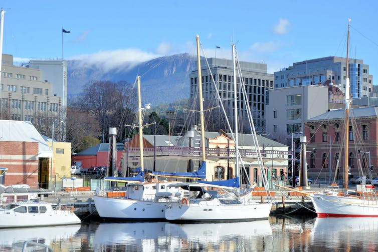 Hobart waterfront with yachts reflected in water