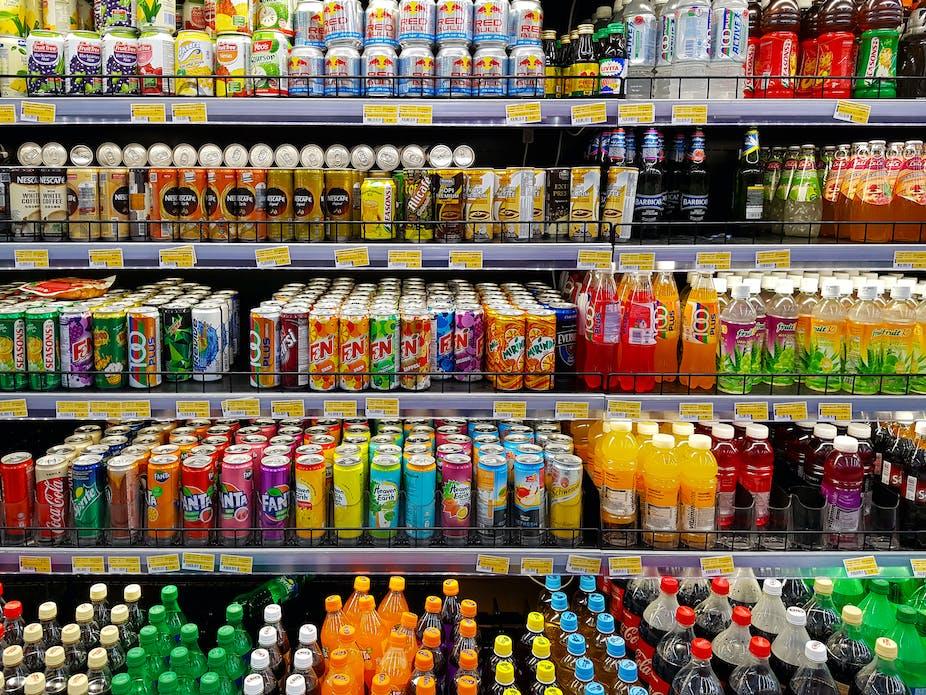 Supermarket shelves full of beverages