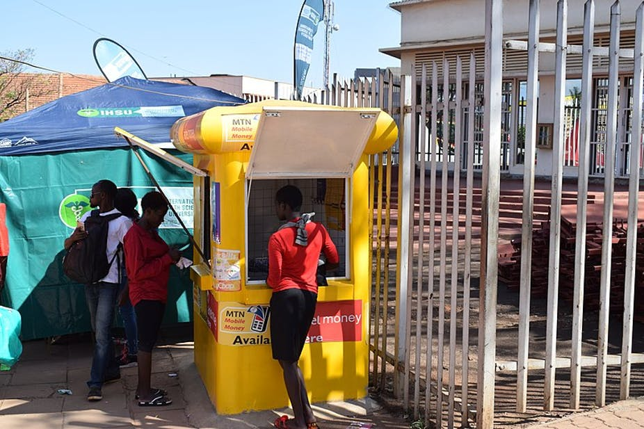 Customers at a mobile money kiosk