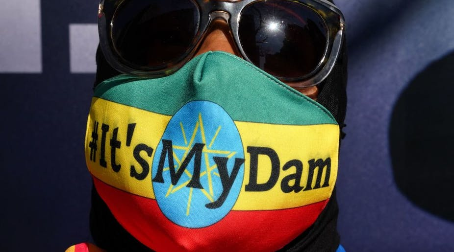 """Ethiopian protestor wears a mask saying """"it's my dam"""""""