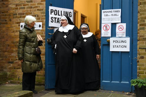 Two nuns leave a polling station after voting in the 2019 general election.