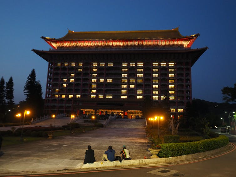 The Taipei Grand Hotel displays English word 'ZERO' in pattern of lights in windows.