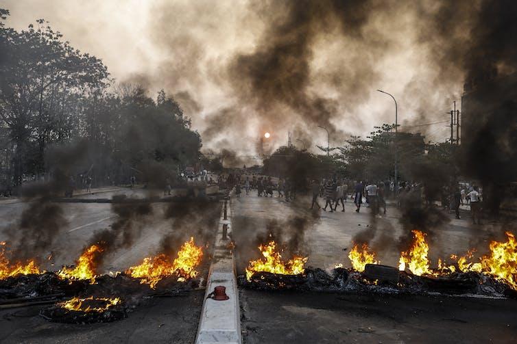 Burning tyres block a main road in Yangon, Myanmar, March 2021.