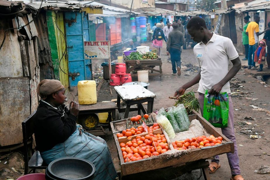 A man shops for vegetables in a low income settlement in Nairobi.