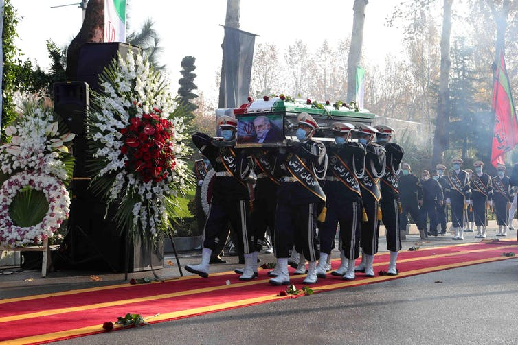 Soldiers carrying the coffin of assassinated Iranian nuclear scientist Mohsen Fakhrizadeh at his funeral in Tehran, November 2020.