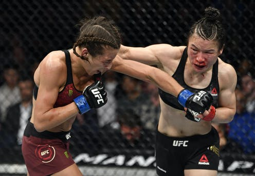 One woman punches another.