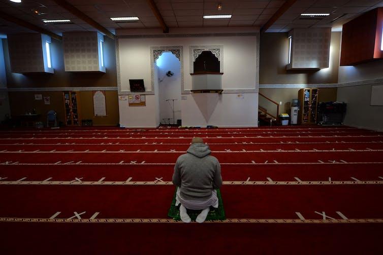 A man prays inside the Avicenna Islamic Cultural centre in Rennes