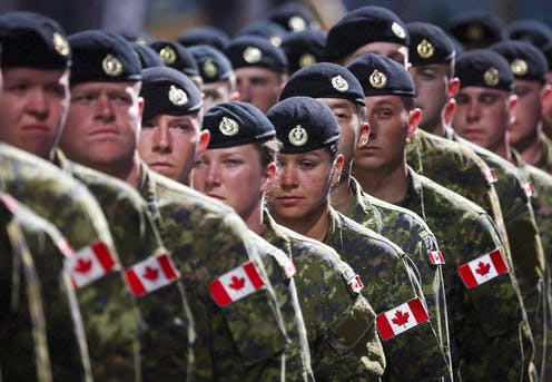 Members of the Canadian Armed Forces march in uniform.