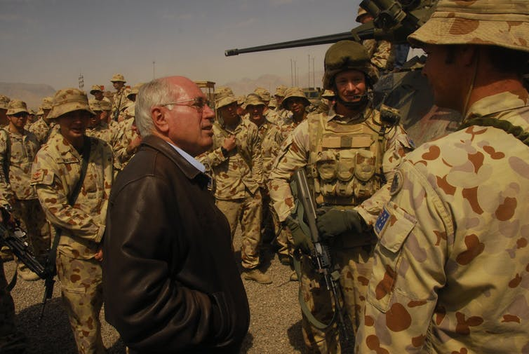 Prime Minister John Howard talks to troops in Afghanistan in 2007.