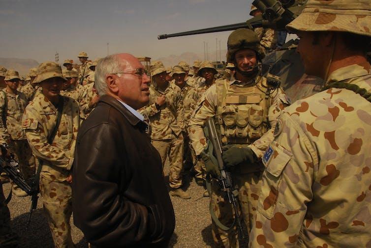 Prime Minister John Howard talks to troops in Afghanistan in 2007.