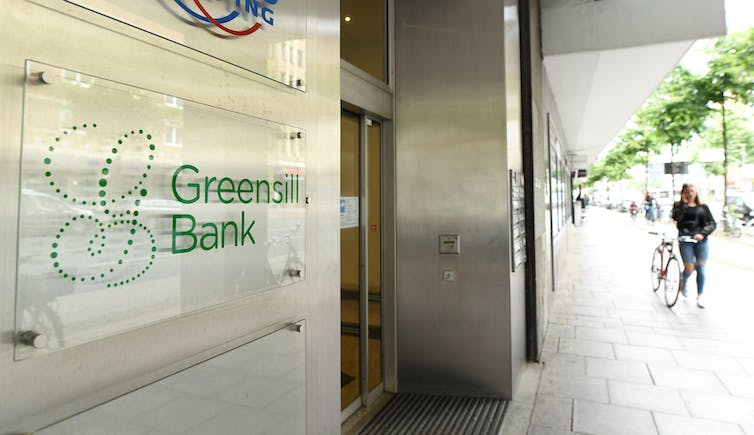 Sign for 'Greensill bank' outside office on city street