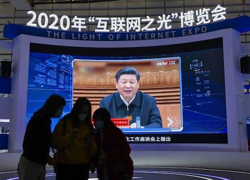 Ji Xinping on screen at an expo