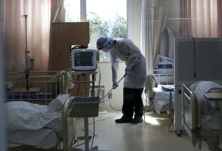 Hospital worker mops floor