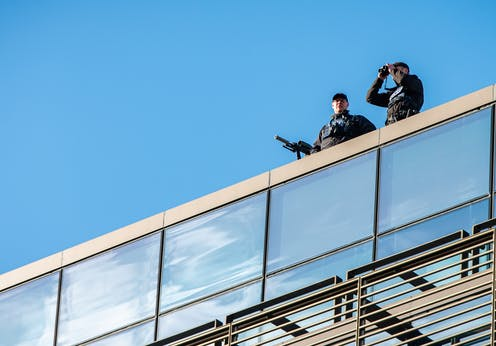 Police snipers on a roof