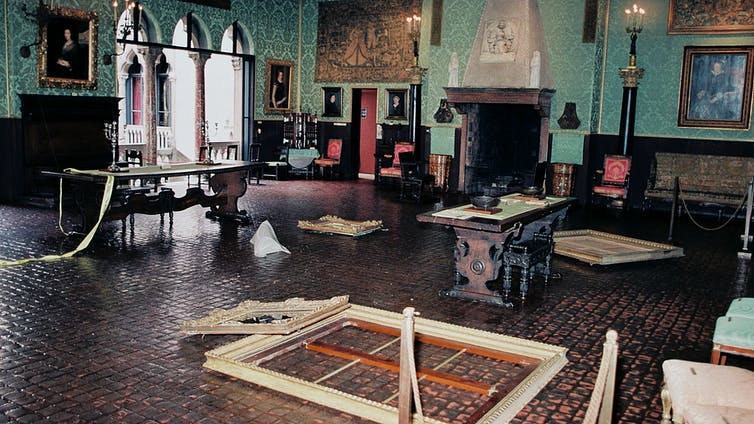 Gallery with damaged frames and artworks