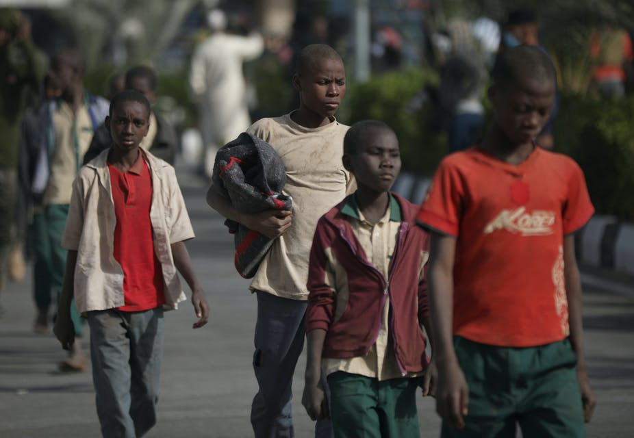 A group of boys walking along a road in Nigeria.