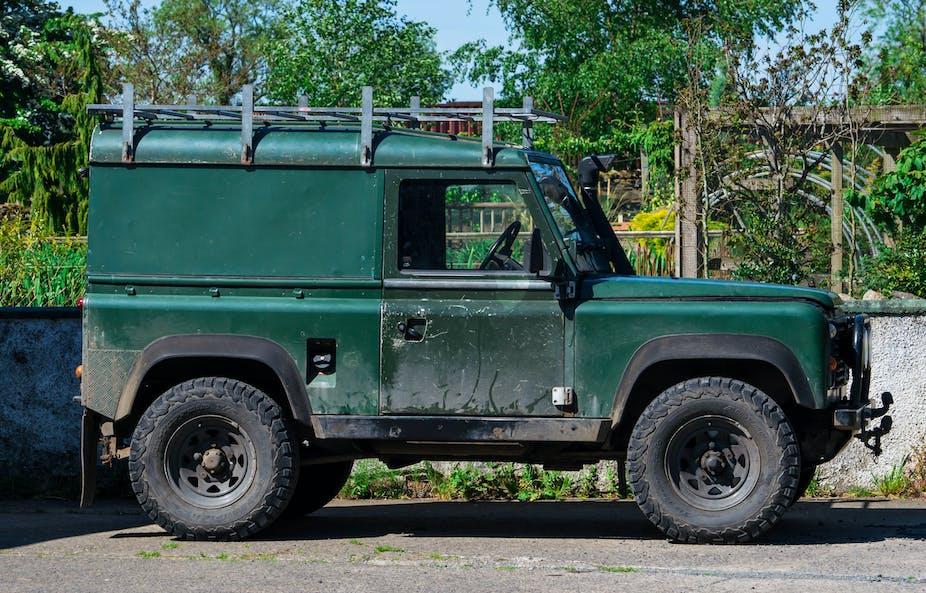 A green Land Rover Defender