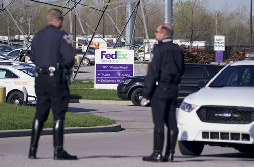 Two police officers in the FedEx parking area in Indianapolis.
