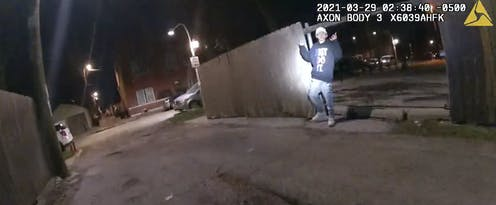 Bodycam footage shows 13-year-old Adam Toledo with his arms raised.