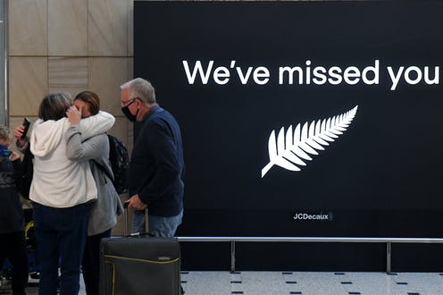 People hug at Sydney Airport