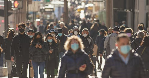 street scene with people in masks