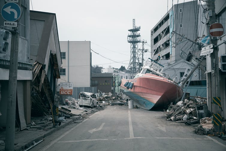 Ship washed up on street after Japanese tsunami