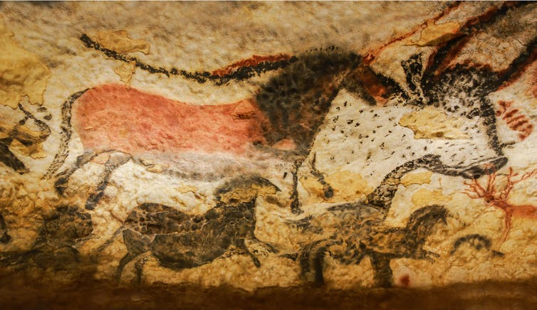 What appear to be bison painted on a cave wall