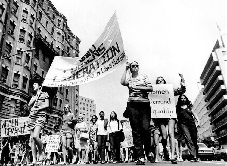 Women marching in the streets of Los Angeles during a women's liberation march 1970s