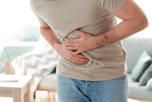 Man holding stomach