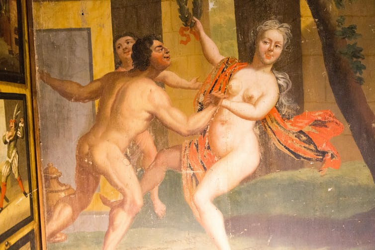 Paintings of a naked woman dancing with a naked man.