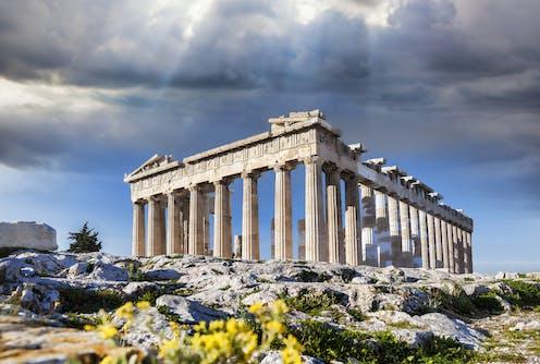 Ancient Greek building against sky backdrop.
