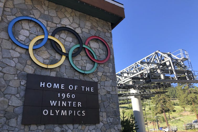 A 1960 Winter Olympics sign hangs on a ski resort in California that is named using a derogatory term for Native women