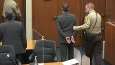 A handcuffed Derek Chauvin is escorted from the courtroom.