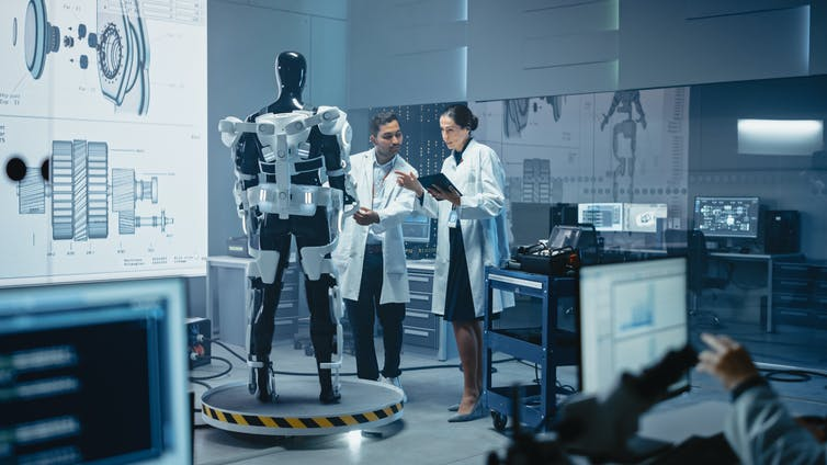 man and woman working in robotics laboratory