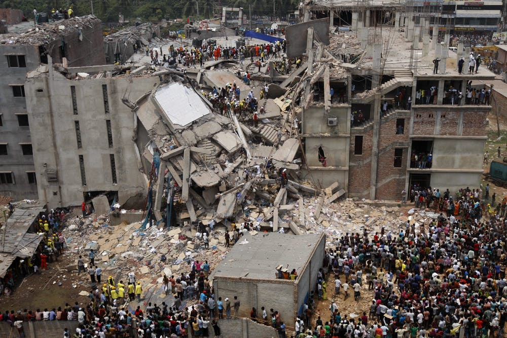 Rescue workers search for survivors in the ruins of the collapsed Rana Plaza building on April 25 2013. Abir Abdullah/EPA