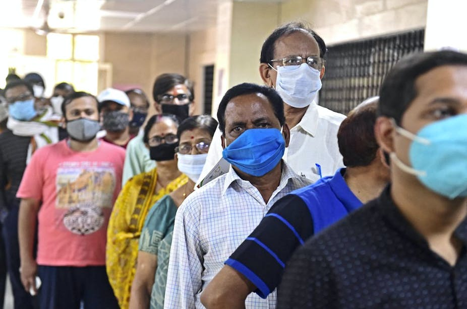 People in India waiting to be vaccinated.