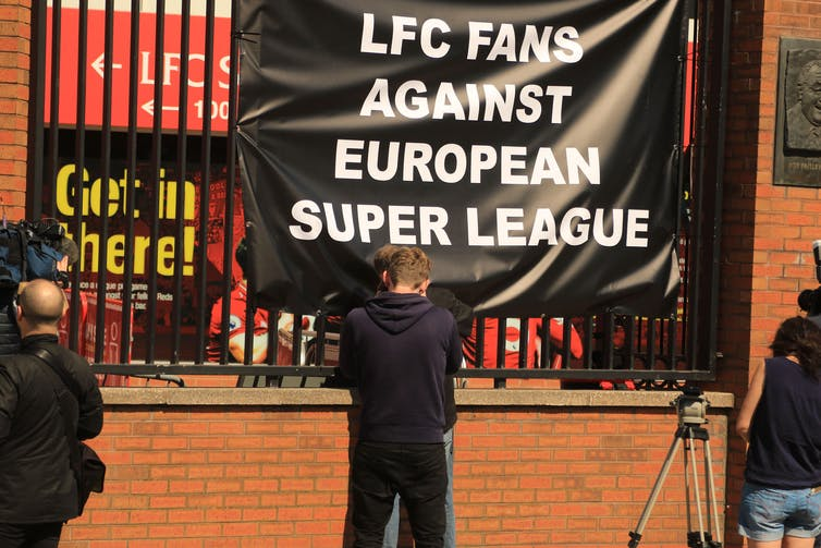 Liverpool supporters protesting ESL with a banner
