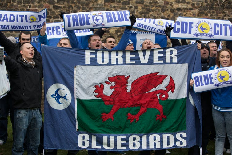 Cardiff City fans with a Forever Bluebirds banner