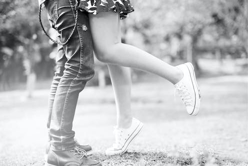Legs of young couple.