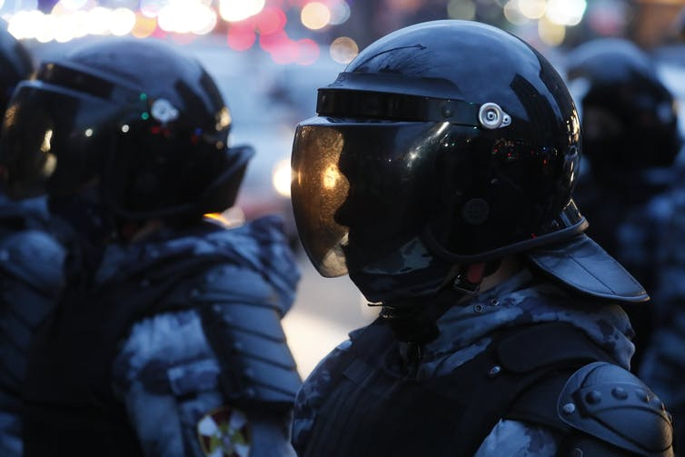 Russian police wearing helmets with full visors at protests against the treatment of dissident leader Alexei Navalny in Moscow, April 21 2021.