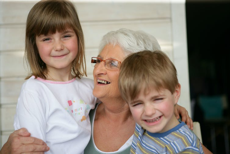 Grandmother with granddaughter and grandson