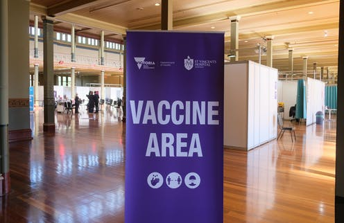 A sign saying 'vaccine area' at the mass vaccination hub at the Royal Exhibition Building in Melbourne