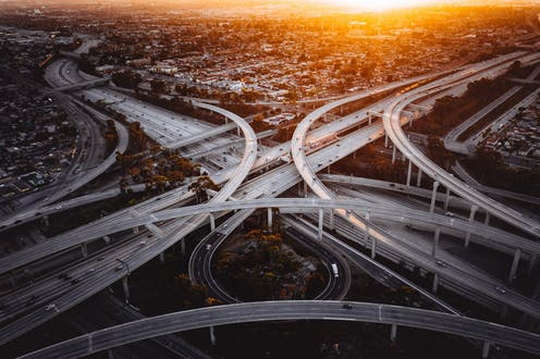 aerial view of overlapping flyovers at freeway interchange