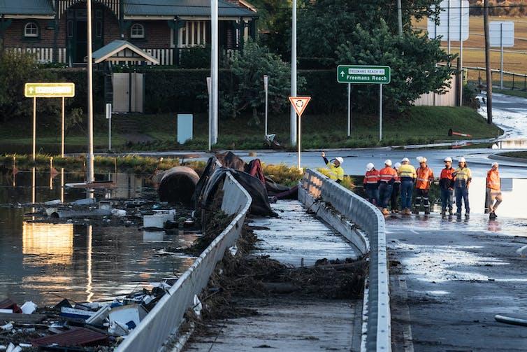 Debris washed up against bridge