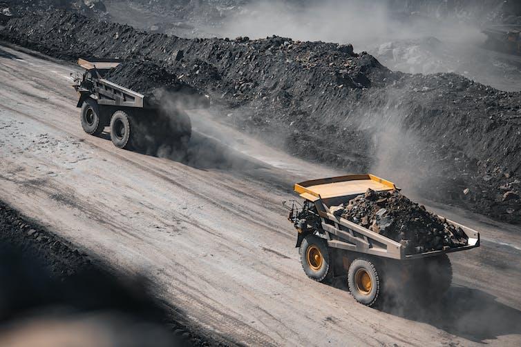 trucks carry coal through mine